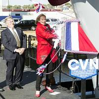 Ship's Sponsor Susan Ford Bales, daughter of President Gerald R. Ford, christens the Navy's newest aircraft carrier. (U.S. Navy photo by Mass Communication Specialist 1st Class Joshua J. Wahl)