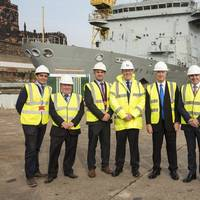 Sir Michael Fallon center with Cammell Laird team John Syvret CEO to his left Linton Roberts managing director to his right (Photo: Cammell Laird Shipyard)