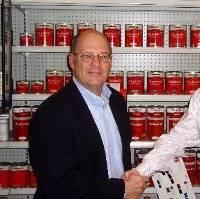 Steve Schultz (left) gets a farewell handshake from Neil Plowman (right), Interlux Global
