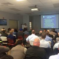 Steven Douglas from the Coast Guard Towing Vessel National Center of Expertise explains the inspections requirements for new and existing towing vessels outlined in Subchapter M, at Illinois Marine Towing Nov. 9, 2016. Douglas presented the information during a forum held to educate more than 80 industry representatives from across the Midwest. (U.S. Coast Guard photo by Lt. Byron Rios)