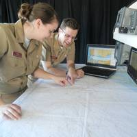Texas A&M students, Holly Ball and Nicholas Mogensen, seniors in the Marine Transportation Department, train with Rose Point Navigation ECS software on the bridge of the academy ship, General Rudder.