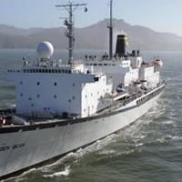 The 500-ft Cal Maritime Training Ship Golden Bear. The Navigation Lab installation is located on the top deck midships, forward of the aft mast and funnel. Photo courtesy The California Maritime Academy
