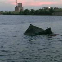 The 57-foot tug, Bonnie G. Selvick, rests in the Calumet River near the 106th Bridge in Chicago after capsizing Aug. 27, 2014.