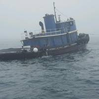The 80-foot tugboat Capt Mackintire in tow on Wednesday, February 21. The tugboat later sank about three miles south of Kennebunk, Maine. (U.S. Coast Guard photo)