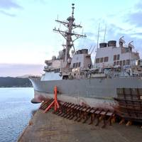 The Arleigh Burke-class guided missile destroyer USS John S. McCain (DDG 56) departs Subic Bay, Philippines aboard heavy lift transport vessel MV Treasure, November 28. Treasure will transport McCain to Fleet Activities Yokosuka to undergo repairs. (U.S. Navy photo by Aaron Van Driessche)
