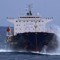 The bulk carrier Golden Seas is towed through rough seas in the Bering Sea by the Tor Viking II Dec. 5, 2010. Photo courtesy of Tor Viking II