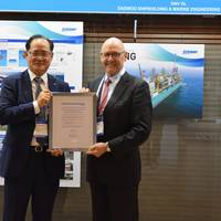 The certificates were presented at DSME's booth at Gastech in Houston (left to right): Odin Kwon, Chief Technology Officer (CTO) of DSME, receives the AIP certificates from Johan Petter Tutturen, DNV GL – Maritime Business Director Gas Carriers (image courtesy of DNV GL)