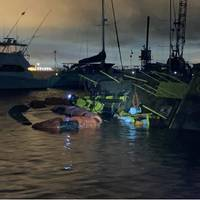 The Coast Guard and partner agencies are responding to a 120-foot dredge barge Capt Leo II that capsized in the Charleston Harbor Resort and Marina, Charleston, South Carolina, August 4, 2021. (Photo: U.S. Coast Guard)