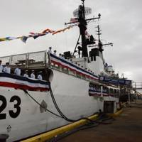 The crew of Coast Guard Cutter Rush line the deck during the beginning of its decommissioning ceremony. (U.S. Coast Guard photo by Melissa E. McKenzie)
