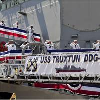 The crew of the guided-missile destroyer USS Truxtun (DDG 103) mans the rails after bringing the ship to life at the ship's commissioning ceremony. (U.S. Navy photo by Rebekah Blowers)