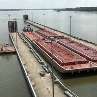 The first tows head through the recently completed Olmsted locks on U.S. inland waters. Characterized as a civil engineering feat of equal stature to that of the famed Manhatten project, the new infrastructure is already yielding dividends for inland stakeholders and the nation's economy.  CREDIT: USACE