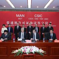 The group photo from the CSIC signing ceremony in Beijing (Photo courtesy of MAN Diesel & Turbo)