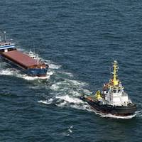 The Janina under tow by Multraship tugs, July 2010 (Photo credit: Sky Pictures)