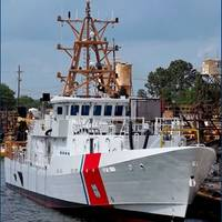 The lead Sentinel-class Fast Response Cutter, the Bernard C. Webber, enters the water for the first time on April 21. The cutter's mast was installed a little over a week after the launch. U.S. Coast Guard photo.
