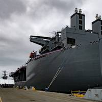 The Lewis B. Puller-class expeditionary mobile base USS Miguel Keith (ESB 5) sits pierside during the ship's commissioning ceremony. (Photo: Kevin C. Leitner / U.S. Navy)