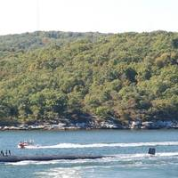 The Los Angeles-class attack submarine USS Providence (SSN 719) transits the Thames River as it departs Naval Submarine Base New London for a six-month deployment. (Photo: U.S. Navy)
