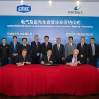 The new joint venture company agreement is signed by Yang Guobing, Chairman of CSSC Electronics Technology Co., Ltd, Ma Yunxiang, Vice chief Economist, Director of Planning and Development Department, CSSC and Stephan Kuhn, Vice President, Electrical & Automation, Wärtsilä Marine Solutions. (Photo: Wärtsilä)