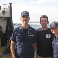 The RDC project team poses on USCGC Hollyhock after completion of the offshore mitigation system prototype test.  From left to right, LT Charles Clark, Alexander Balsley, and Coast Guard Academy Cadet 2/c Valerie Hines.)
