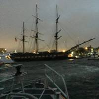 The SSV Oliver Hazard Perry, an educational tall ship homeported in Newport, R.I. is grounded Sunday, October 11, 2017 in Newport Harbor after the ship lost power and hit multiple other boats near Perrotti Park. (U.S. Coast Guard photo)