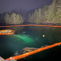 The submerged 52-foot fishing vessel, Haida Lady, surrounded by boom, February 26, 2021. Coast Guard Sector Juneau personnel received a report that the vessel sank. - U.S. Coast Guard photo by MSD Sitka personnel (Photo: Alexandria Preston / U.S. Coast Guard)