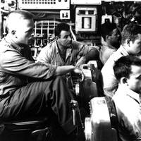 The watch crew in the control room of the USS Nautilus (SSN-571) maintain exact course and depth while the ship is passing under the polar ice gap. U.S. Navy Photo.