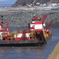 The Westport, a red and white hopper dredge operated by Manson Construction, dredges near the Port of Alaska on April 3, 2019. From May 1 to Nov. 1 each year, the U.S. Army Corps of Engineers removes built-up sediment from the seafloor near the Port of Alaska to maintain shipping channels and dock access. An estimated 50 percent of all goods entering Alaska come through this port. (Photo: U.S. Army)