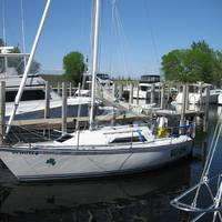 The Wild Irish, a 26-foot sailboat. Kiehm is reported to be on the boat in Lake Michigan.
