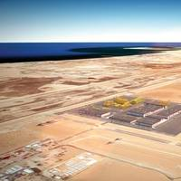 This artist rendition and those at the top of the page show what the facility — which will span 500,000 square meters — will look like. Image: Saudi Aramco