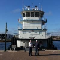 Travis R. Short of Horizon Shipbuilding with Jeff Brumfield of FMT in front of newbuild M/V Michael Akiu #86  (Photo: Horizon Shipbuilding)