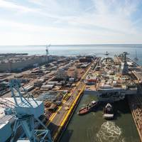 Tugboats move the aircraft carrier John F. Kennedy (CVN 79) from Newport News Shipbuilding's Dock Dry 12 to Pier 3, where the ship will undergo final completion and outfitting before planned delivery to the U.S. Navy in 2022. (Photo: Matt Hildreth/HII)