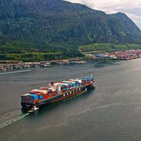 Tugs escort a container vessel to Fairview Container Terminal