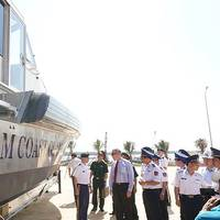 US Ambassador Ted Osius, fourth from left, inspects new Metal Shark patrol boats with Vietnam Coast Guard members during a delivery ceremony Monday May 22, 2017 in Quang Nam, central Vietnam (Photos courtesy US Embassy Hanoi)