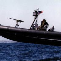 (U.S. Navy photo) Naval Special Warfare (NSW) 11-meter Rigid-Hull Inflatable Boat (RIB) during a training exercise conducted by Naval Amphibious Base (NAB) Coronado, San Diego. The airborne launch shown here is not uncommon for such craft.  Landings are characterized by high-acceleration impacts that may be damaging to structure, mechanical and electrical systems, and people.