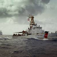 USCG Cutter Sapelo and the Royal Netherlands Navy Offshore Patrol Vessel HNLMS Holland search Caribbean Sea waters for bales of contraband jettisoned by Dominican drug smugglers.