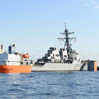 USS Fitzgerald is loaded onto heavy lift transport MV Transshelf for transport to Pascagoula, Miss. to complete repairs. (U.S. Navy photo by William McCann)