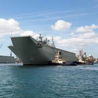 Australia's second Landing Helicopter Dock (LHD) ship, HMAS Adelaide, arriving at its new home at Fleet Base East Garden Island, Sydney. (Photo courtesy of the RAN)