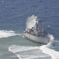 Waves Break Over USS Guardian: Photo credit USN