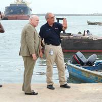 William H. Watson, president of AdvanFort International, center, surveys the Port of Cotonou with Ric Hedlund, AdvanFort's Director of Port Security, in preparation for providing counter-piracy services to commercial customers.