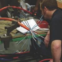 Work on the DCN Cable: Photo credit MacArtney BeneluxMacArtneyBenelux