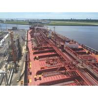 File Image: A domestic product tanker transfers cargo alongside a U.S. pier (CREDIT: Crowley)