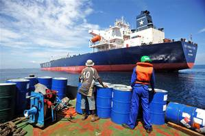 A crew member prepares to board a tanker that was hijacked by pirates in Benin on July 24, 2011. Photo: IRIN/Daniel Hayduk