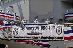 The crew of the guided-missile destroyer USS Truxtun (DDG 103) mans the rails after bringing the ship to life at the ships commissioning ceremony. (U.S. Navy photo by Rebekah Blowers)