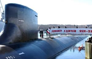 The crew assigned to the Jimmy Carter (SSN-23) bring her to life as they board the newly commissioned Seawolf-class nuclear-powered attack submarine at Naval Submarine Base Groton, Conn., February 19, 2005. (U.S. Navy photo: Roadell Hickman)