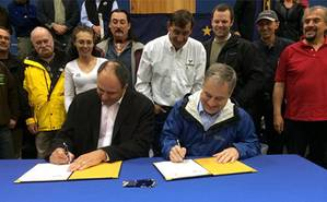 An announcement was made September 20 that Alaskas new ferries will be built in Southeast Alaska. Adam Beck, President of Vigor Alaska and Alaska Governor Parnell sign the agreement. (Photo courtesy Office of the Governor)