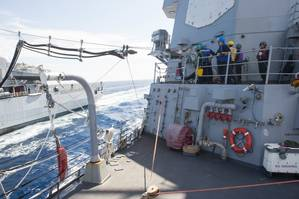 Guided-missile destroyer USS Mason prepares to seat a fuel probe delivered from the Italian oiler ITS Etna during a practice replenishment-at-sea. (U.S. Navy photo by Anderson W. Branch)