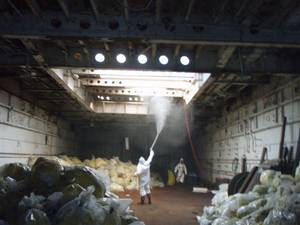 File photo: Workers clean the interior of a cargo hold aboard the LST-1166. (U.S. Coast Guard photo/Pacific Strike Team)