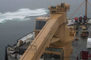Crew members aboard Coast Guard Cutter Maple stand lookout watch in the Arctic Ocean approximately 100 miles east of Barrow, Alaska, July 25, 2017. This was the first day of the patrol the crew encountered ice. (U.S. Coast Guard photo by Nate Littlejohn)