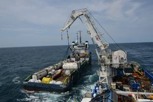 Crews aboard M/V SHELIA BORDELON offload more than 450,000 gallons of oil from the Coimbra shipwreck 30 miles offshore from Shinnecock, N.Y. U.S. Coast Guard responders discovered a significant amount of oil in cargo and fuel tanks during onsite assessments of the Coimbra in May 2019. (US Coast Guard photo by Michael Himes)