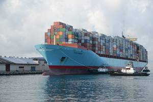 The containership Sofie Maersk is escorted by tugs into Honolulu Harbor. (U.S. Coast Guard photo by Amanda Levasseur)
