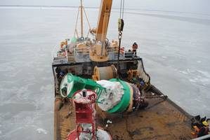 FILE PHOTO: Members of the Coast Guard Cutter William Tate perform buoy tending operations on the Delaware River (Photo: U.S. Coast Guard)